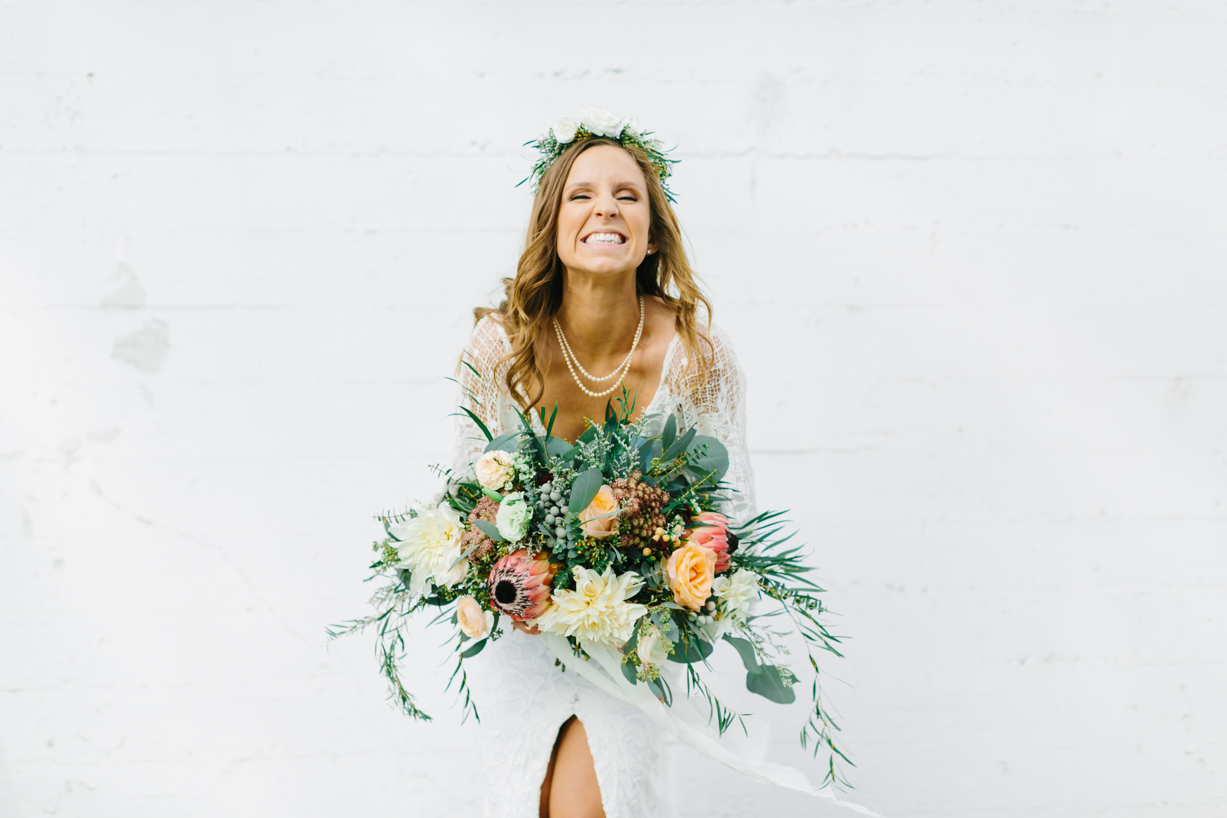 Beachy, boho chic wedding with proteas and dahlias