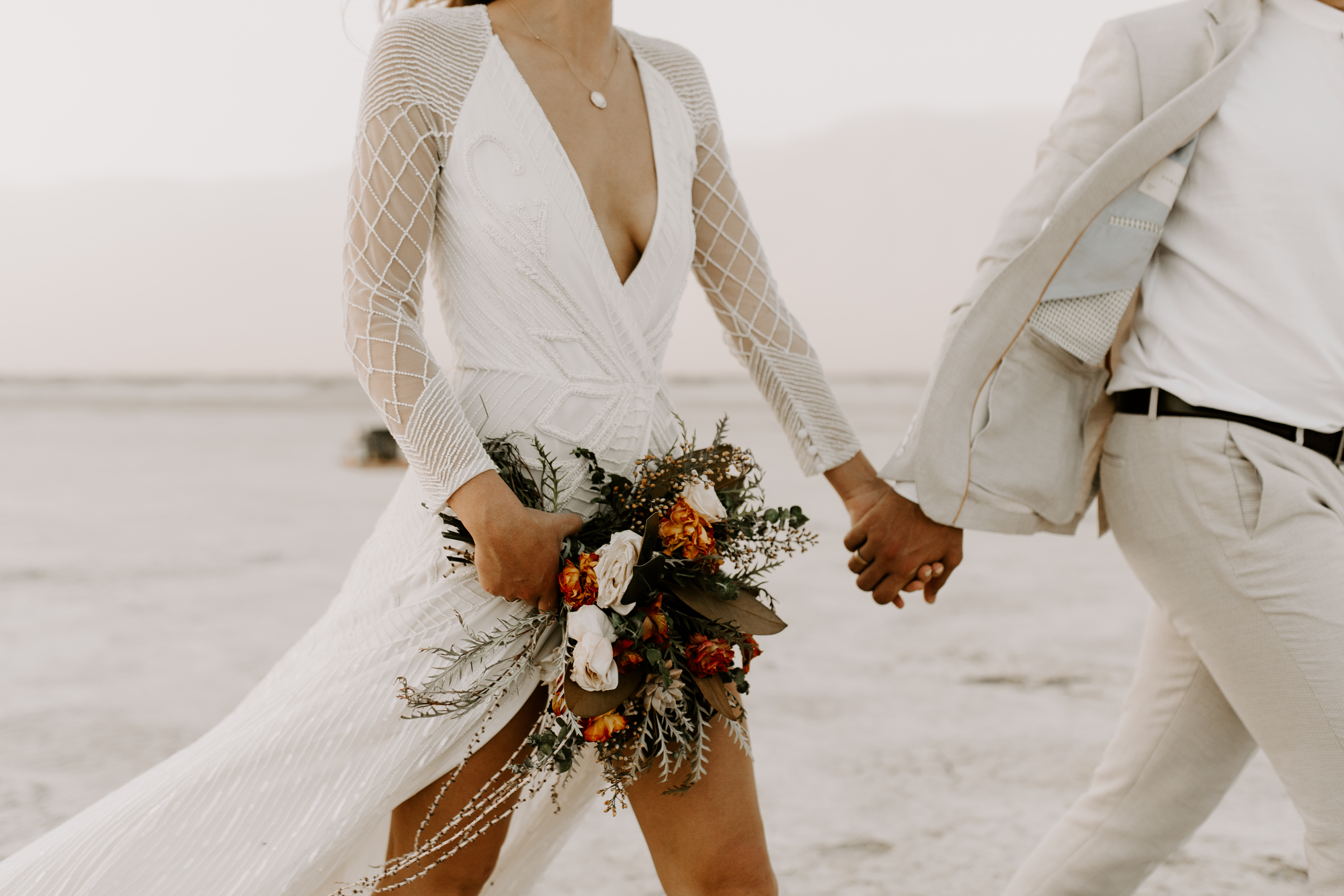This white and firey red toned wedding shoot gave me so many feelings. The still white stillness of the dessert has always shocked me. Stark. Stunning. I loved the vibrant deep tones of this bouquet and how much it complemented the dessert.
