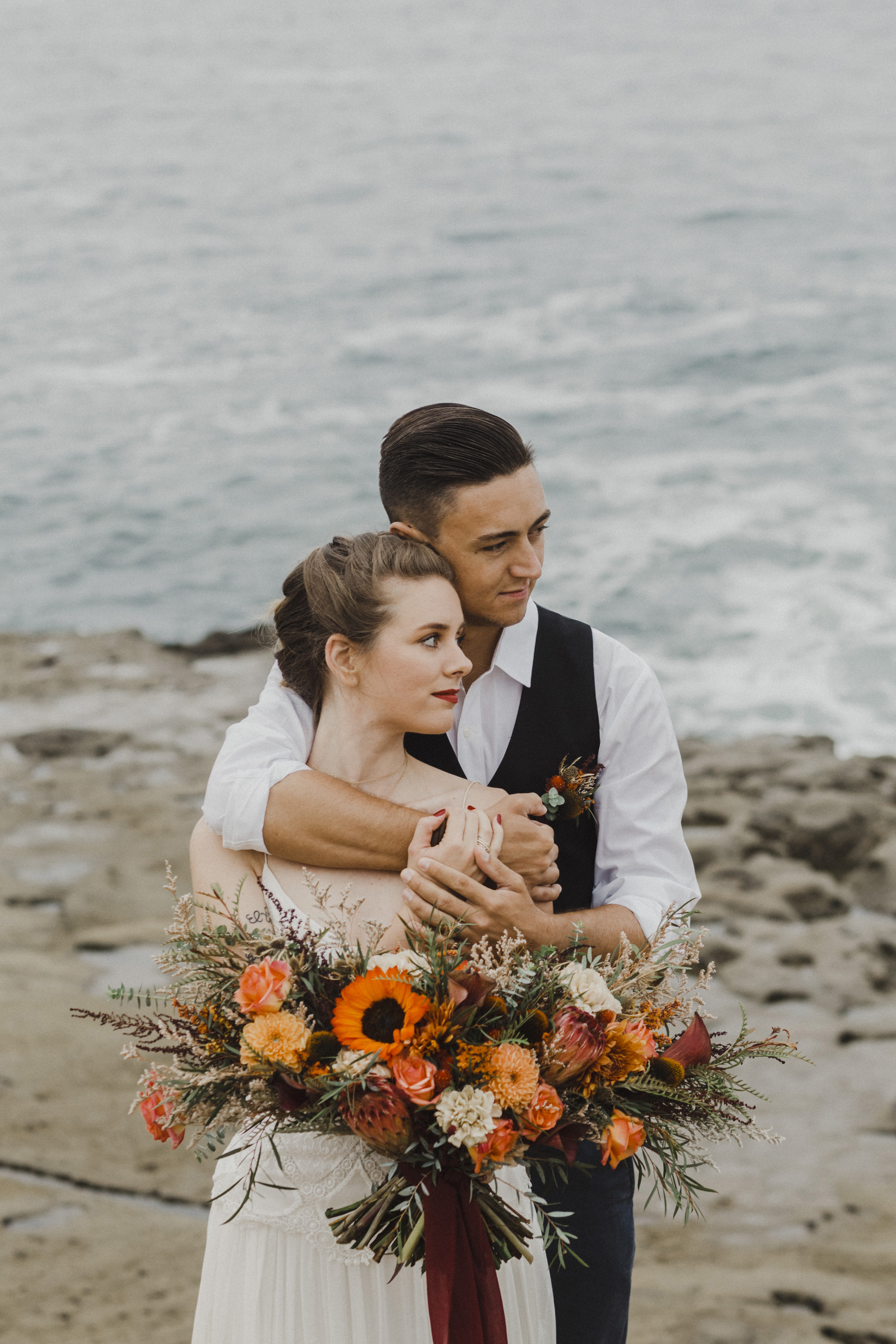 Moody wedding flowers at the beach.